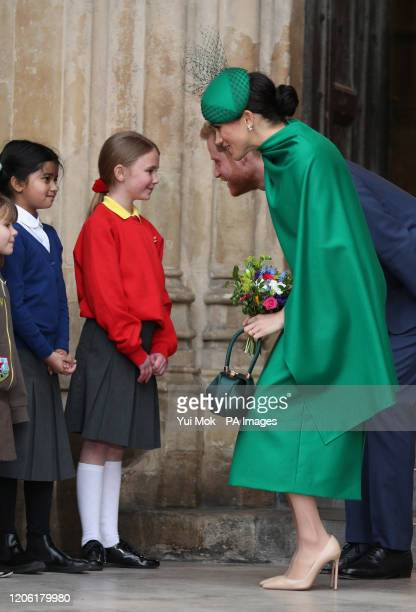 The Duke and Duchess of Sussex speak to school children as they leave after the Commonwealth Service at Westminster Abbey, London on Commonwealth...