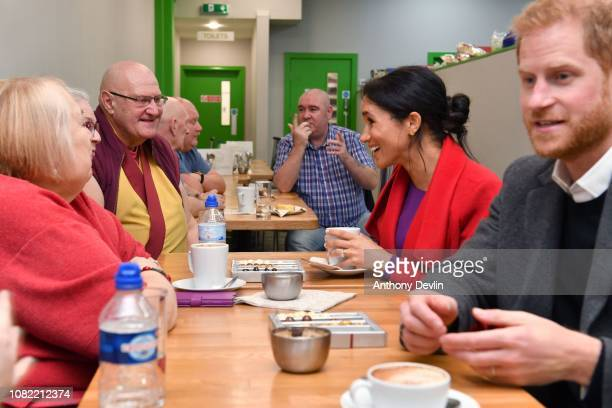 The Duke and Duchess of Sussex speak with members as they officially open Number 7 a Feeding Birkenhead citizens supermarket and community cafe on...