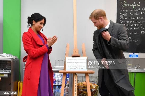 The Duke and Duchess of Sussex unveil a plaque as they officially open Number 7 a Feeding Birkenhead citizens supermarket and community cafe on...