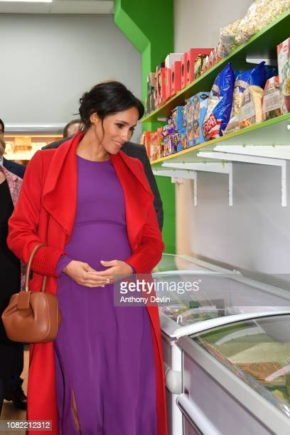 The Duke and Duchess of Sussex view the mini supermarket as they officially open Number 7 a Feeding Birkenhead citizens supermarket and community...