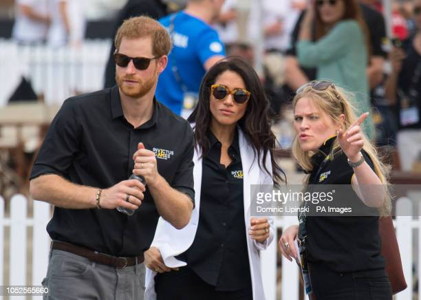 The Duke and Duchess of Sussex with the Duchess's Private Assistant Secretary Amy Pickerill at the Invictus Games Jaguar Land Rover Driving Challenge...