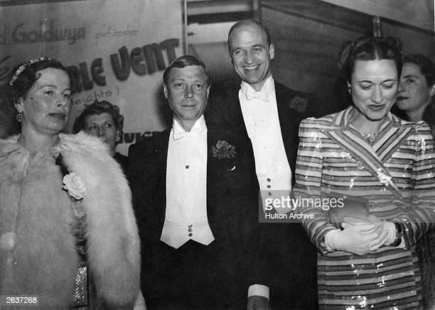 The Duke and Duchess of Windsor along with James Roosevelt attending the premiere of the film 'Gone with the Wind' Paris France