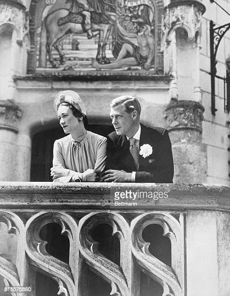 The Duke and Duchess of Windsor gaze from a balcony on their wedding day Edward VIII's marriage to Wallis Warfield Simpson created a constitutional...