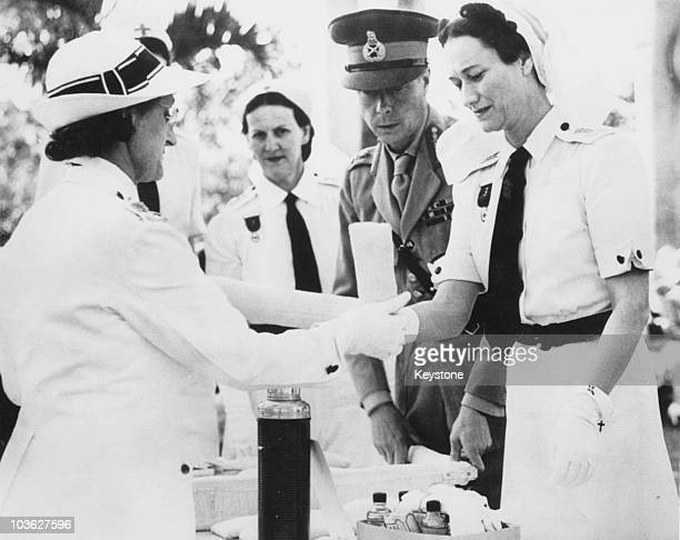 The Duke and Duchess of Windsor host the annual inspection of the Bahamas branch of the Red Cross at Government House in Nassau 1942 Here Mrs T M...