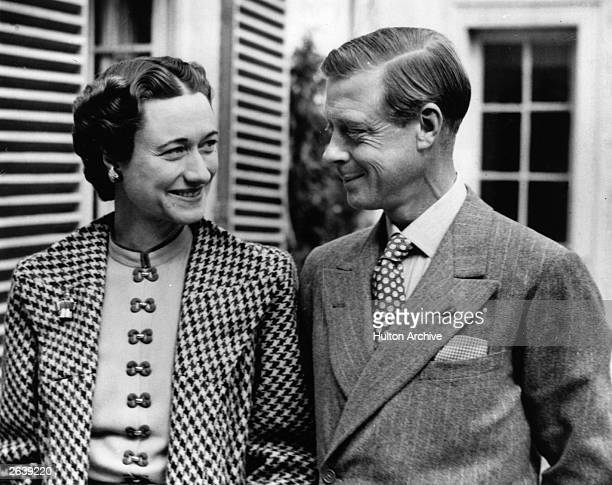 The Duke and Duchess of Windsor in England after an absence of nearly three years in the garden of Major Edward Dudley Metcalfe's country house...