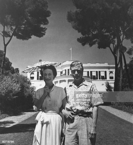 The Duke and Duchess of Windsor on the Riviera the Duchess is using a parasol to shield her from the sun