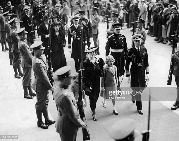 The Duke and Duchess of York and their daughters pass through a Guard of Honour on their way to Olympia in London November 1935 Original Publication...