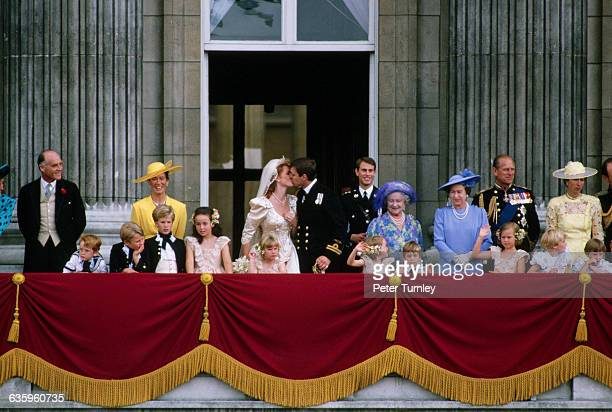 The Duke and Duchess of York and their wedding party stand on the balcony of Buckingham Palace after their wedding