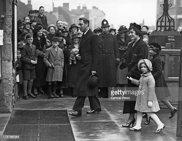 The Duke and Duchess of York (later King George VI and the Queen Mother, arriving at a church service in Eastbourne, East Sussex, with their...