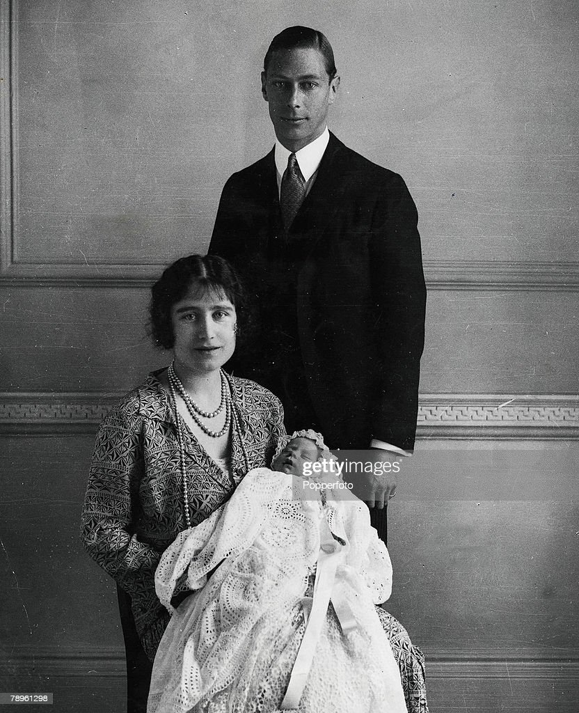 1926, The Duke and Duchess of York (later King George VI and Queen Elizabeth, the Queen Mother) pictured with their daughter (later, Queen Elizabeth II) as she sleeps in a precious christening robe, which has been used in the Royal Family for generations