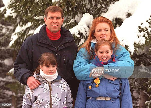 The Duke and Duchess of York pose for photographers while on Vacation In Verbier Switzerland with children Princess Beatrice and Eugenie February 19...