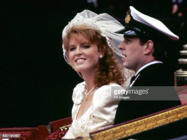 The Duke and Duchess of York smile happily during their carriage procession after their wedding at Westminster Abbey in London
