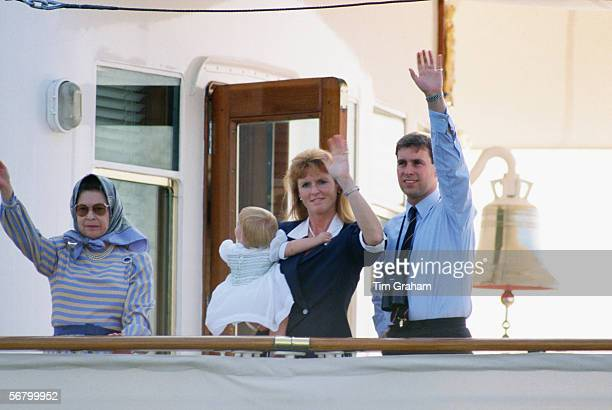 The Duke and Duchess of York with Princess Beatrice join Queen Elizabeth II aboard Royal Yacht Britannia for a summer cruise.