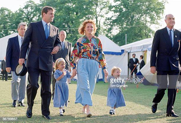 The Duke and Duchess of York with their daughters Beatrice and Eugenie at the Windsor Horse Show Accompanying them is Ronald Ferguson Sarah's father