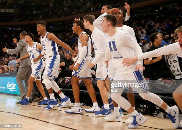 The Duke Blue Devils bench celebrates after teammate Cassius Stanley dunked in the second half against the Kansas Jayhawks during the State Farm...