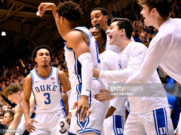 The Duke Blue Devils bench reacts after a three-point shot by Wendell Moore Jr. #0 of the Duke Blue Devils during the second half of their game...