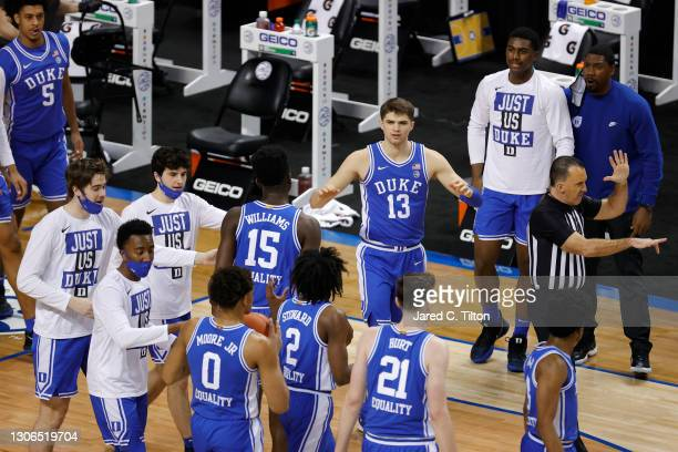 The Duke Blue Devils bench reacts during the first half of their second round game against the Louisville Cardinals in the ACC Men's Basketball...