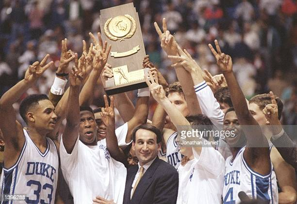 The Duke Blue Devils celebrate a victory during the NCAA Final Four tournament. Mandatory Credit: Jonathan Daniel /Allsport