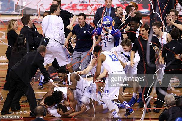 The Duke Blue Devils celebrate after defeating the Wisconsin Badgers during the NCAA Men's Final Four National Championship at Lucas Oil Stadium on...