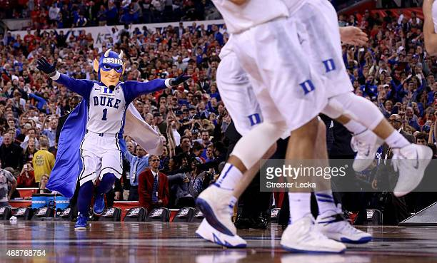 The Duke Blue Devils celebrate as their mascot runs on the floor after defeating the Wisconsin Badgers during the NCAA Men's Final Four National...