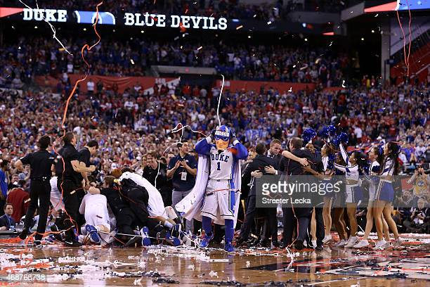 The Duke Blue Devils celebrate on the court after defeating the Wisconsin Badgers during the NCAA Men's Final Four National Championship at Lucas Oil...