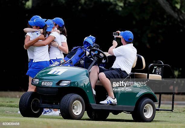 The Duke Blue Devils celebrate winning the 2016 East Lake Cup at East Lake Golf Club on November 2 2016 in Atlanta Georgia