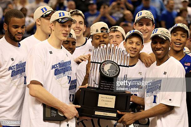 The Duke Blue Devils celebrate with the ACC Championship Trophy after their 75-58 victory over the North Carolina Tar Heels in the championship game...