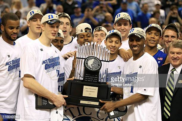 The Duke Blue Devils celebrate with the ACC Championship Trophy after their 7558 victory over the North Carolina Tar Heels in the championship game...