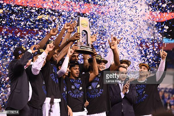 The Duke Blue Devils celebrate with the championship trophy after defeating the Wisconsin Badgers during the NCAA Men's Final Four Championship at...