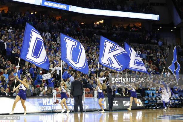 The Duke Blue Devils cheerleaders carry their schools flags on to the court prior to the 2018 NCAA Men's Basketball Tournament Midwest Regional...