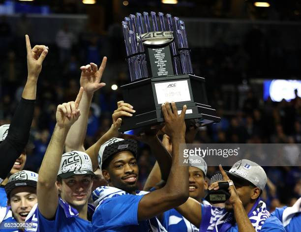 The Duke Blue Devils hold up the trophy after defeating the Notre Dame Fighting Irish 7569 in the championship game of the 2017 Men's ACC Basketball...