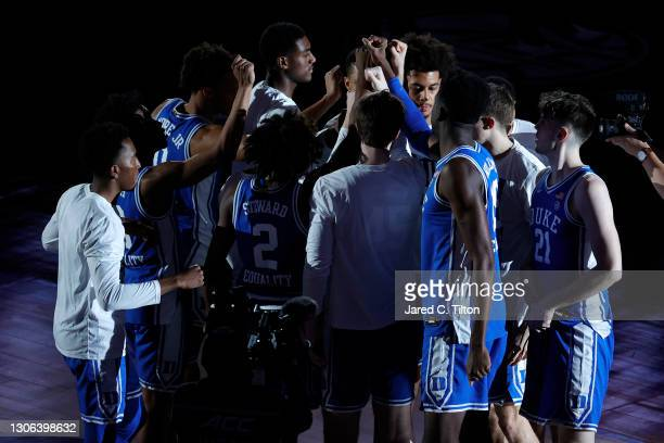 The Duke Blue Devils huddle prior to their second round game against the Louisville Cardinals in the ACC Men's Basketball Tournament at Greensboro...