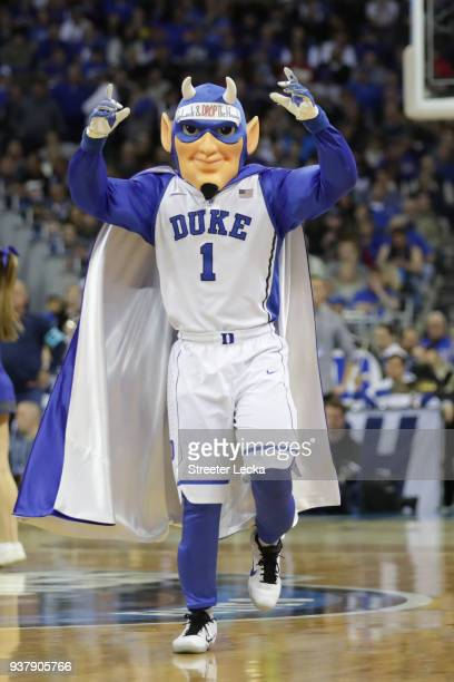 The Duke Blue Devils mascot performs during the first half in the 2018 NCAA Men's Basketball Tournament Midwest Regional between the Kansas Jayhawks...