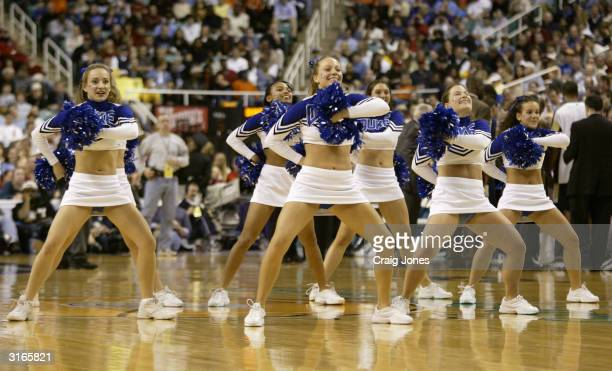 The Duke Blue Devils performs on the court in the ACC Semifinal game against the Georgia Tech Yellow Jackets on March 13, 2004 at the Greensboro...