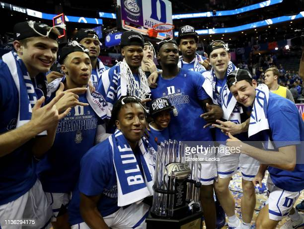 The Duke Blue Devils pose with the ACC Championship trophy after defeating the Florida State Seminoles 7363 in the championship game of the 2019...