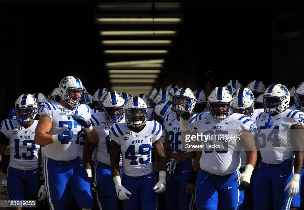 The Duke Blue Devils prepare to run onto the field before their game against the North Carolina Tar Heels at Kenan Stadium on October 26 2019 in...
