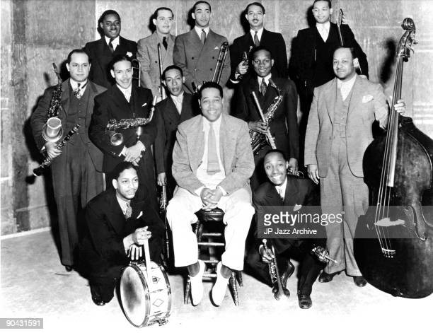 The Duke Ellington Orchestra pose for a group shot in 1934 with Duke Ellington in centre Sonny Greer kneeling left and Freddy Jenkins right then...