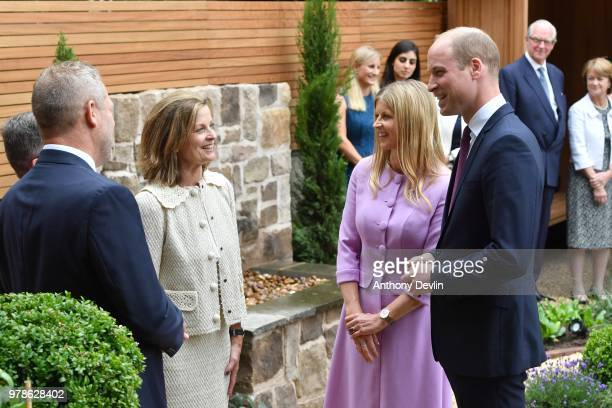The Duke of Cambridge and Clare Milford Haven speak with garden designer Louise del Balzo during a visit to James' Place in Liverpool on June 19 2018...