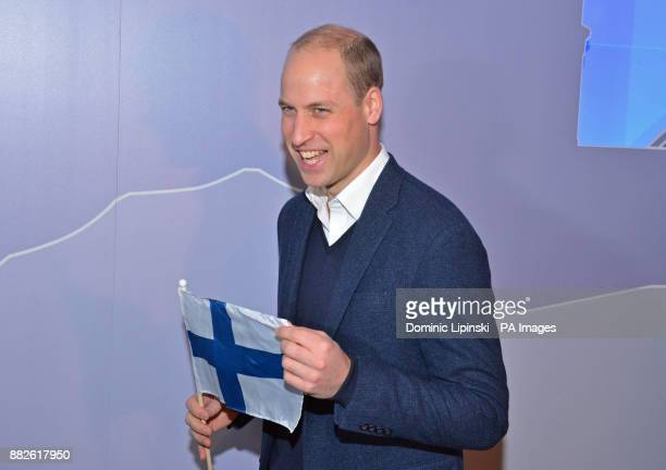 The Duke of Cambridge holding a Finnish flag as he attends the tech festival Slush in Helsinki Finland