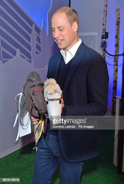 The Duke of Cambridge is presented with two hobby horses as he attends the tech festival Slush in Helsinki Finland