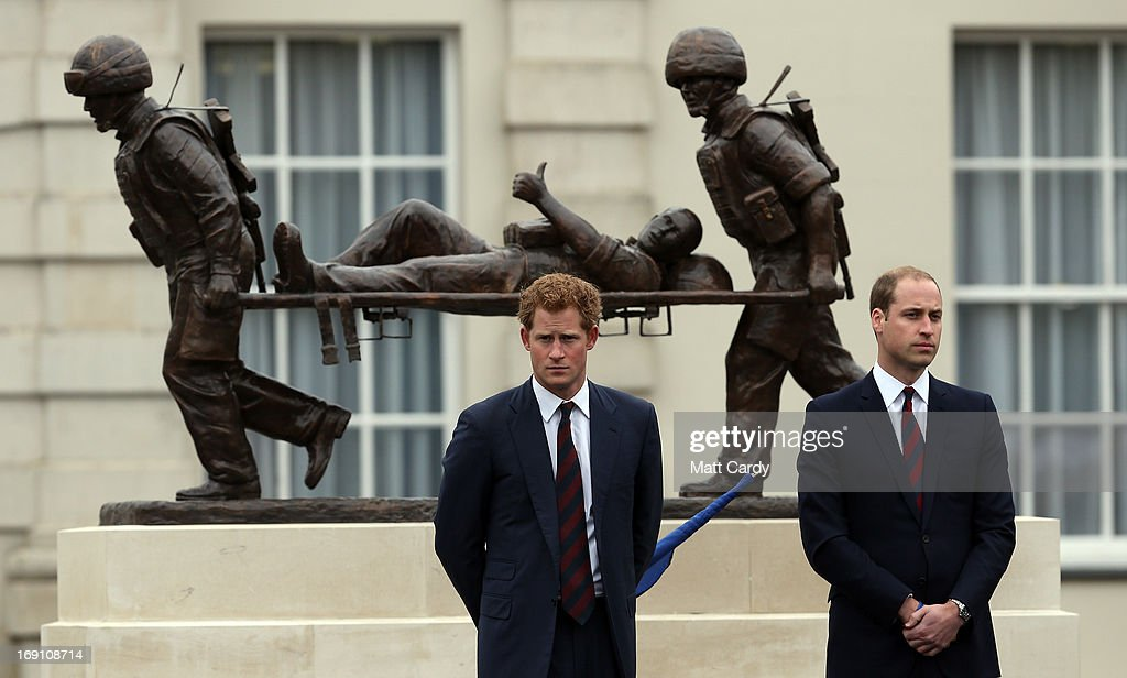 The Duke of Cambridge, Prince William and Prince Harry stand in front of the Help for Heroes statue as they officially open the charity's Tedworth House recovery centre on May 20, 2013 in Tidworth, England. During their visit the two Royal Princes met with wounded veterans, serving personnel, and their families. Tedworth House in Wiltshire is one of four new units in England which will offer respite care and rehabilitation to injured and sick service personnel, veterans and their families.