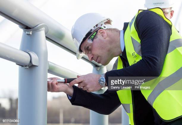 The Duke of Cambridge puts one of the final bolts on the Northern Spire bridge across the River Wear in Sunderland