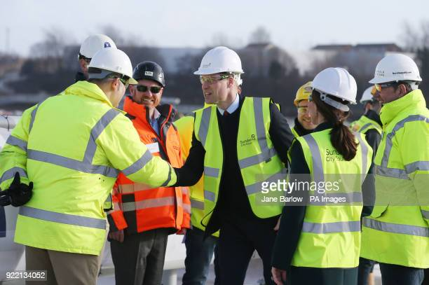 The Duke of Cambridge wear a safety helmet and high visibility vest during a visit to the Northern Spire bridge across the River Wear in Sunderland