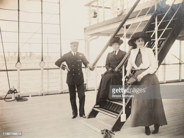 The Duke of Connaught poses for a portrait with his wife, Duchess Luise Margarete, and his daughter, Princess Patricia, on the deck of S.S. Balmoral...