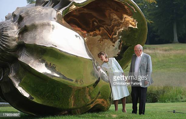 The Duke of Devonshire and Duchess of Devonshire view a piece of art titled 'Spiral of the Galaxy' is displayed in the grounds of Chatsworth House as...