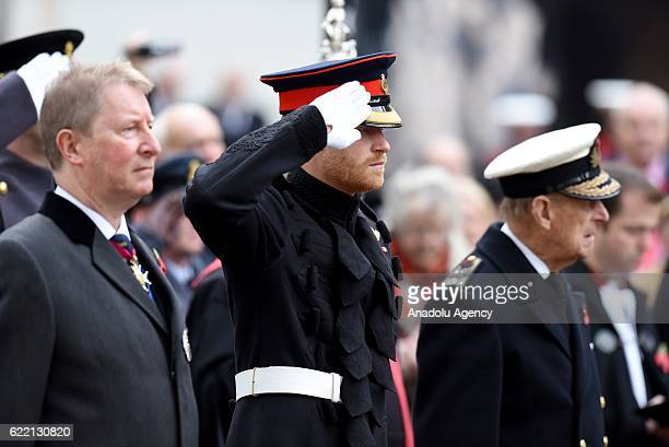 The Duke of Edinburgh accompanied by Prince Harry visit the Field of Remembrance at Westminster Abbey on November 10th 2016 in London England