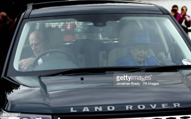 48c6757aff5 The Duke of Edinburgh and Queen Elizabeth II arrive for the Cartier Queen s  Cup polo tournament