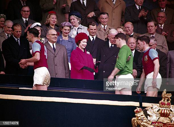 The Duke of Edinburgh and Queen Elizabeth II greet the Burnley football team after their 31 defeat by Tottenham Hotspur in the FA Cup Final at...