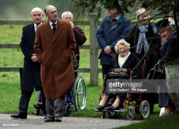 The Duke of Edinburgh and Queen Elizabeth II leaves St Mary Magdalene's Church on the Sandringham Estate Sandringham Norfolk after attending the...