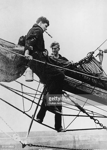 The Duke of Edinburgh as a young man working on some rigging with a friend circa 1935